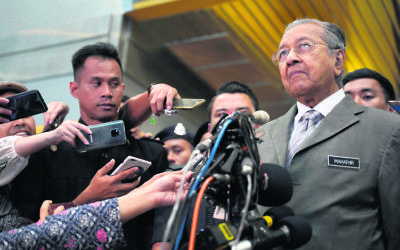 Malaysia's Prime Minister Mahathir Mohamad faces the media on Monday. Photo: AP Photo/Yam G-Jun