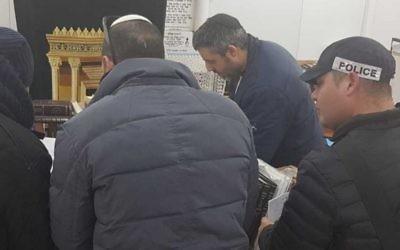 Police enter the study hall of the Pri Haaretz Yeshivah high school in the West Bank settlement of Rehelim on January 9. Photo: Honenu/Elishuv Har-Shalom