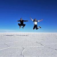 Iddo Snir and Rachel Flitman jumping at the Salt Flats, near Uyini, Bolivia