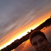 Ashley Morris taking a selfie at Shearwater Reserve at sunset.