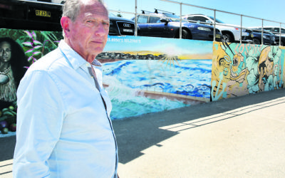 Holocaust survivor Peter Halas at Bondi Beach in front of Anthony Glick's mural – one of many that was defaced in last weekend's antisemitic graffiti attack. Photo: Noel Kessel