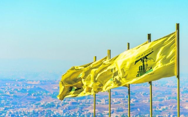 Hezbollah flags in southern Lebanon. The UK will be banning Hezbollah in its entirety, not just its military wing. Photo: John Grummet/Dreamstime.com