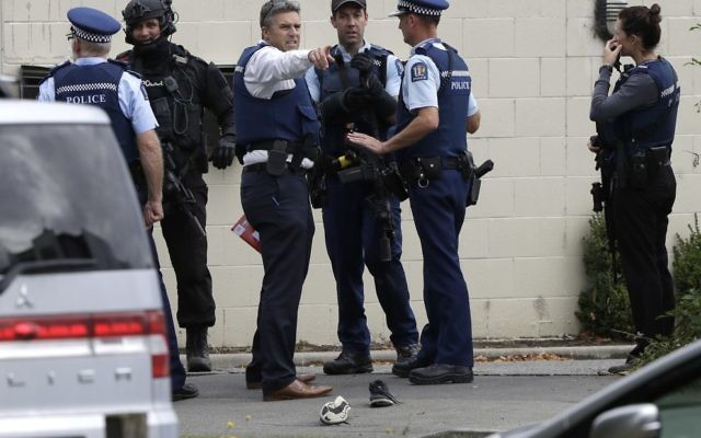 Police stand outside a mosque in central Christchurch, New Zealand, Friday, March 15, 2019. Multiple people were killed in mass shootings at two mosques full of people attending Friday prayers, as New Zealand police warned people to stay indoors as they tried to determine if more than one gunman was involved. (AP Photo/Mark Baker)