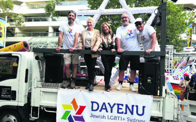 Dr Kerryn Phelps (second from left) with her wife Jackie and three other members of Dayenu at the 2019 Sydney Gay and Lesbian Mardi Gras.