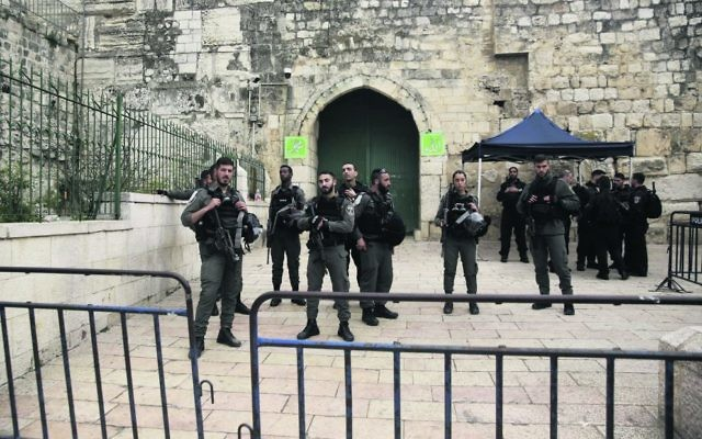 Israeli border police block the entrance to al-Aqsa compound in Jerusalem last Tuesday after Palestinian suspects threw a firebomb at a police station. Photo: AP Photo/Mahmoud Illean