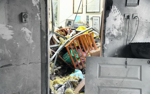 An Israeli house hit by a Hamas rocket this week. Photo: Israel Police