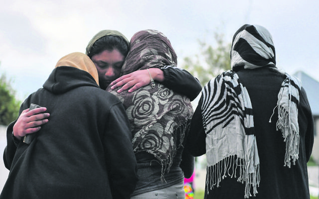 Muslim worshippers grieving at a makeshift memorial at Christchurch's Al Noor Mosque. Photo: AAP Image/Mick Tsikas