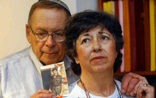Miriam and Yonah Baumel hold a picture of their son Zachary Baumel, who was taken prisoner of war in 1982, in Jerusalem on July 07, 2003. Photo: FLASH90