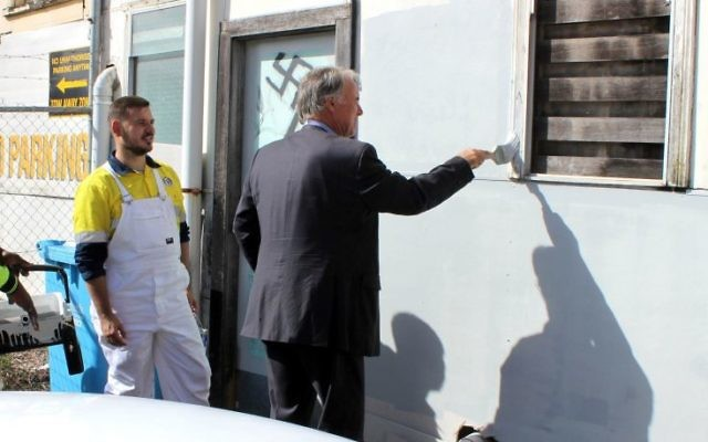 Bennelong MP John Alexander removing the graffiti in Epping. Photo: Facebook