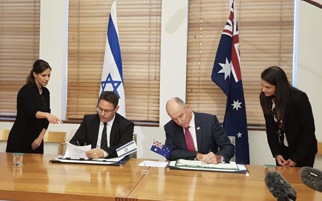 Israeli deputy chief of mission Ron Gerstenfeld (left) and Australian assistant treasurer Stuart Robert sign the deal. Photo: Twitter