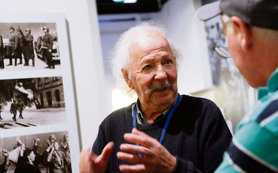 Henri Korn, Holocaust survivor and guide at the Jewish Holocaust Centre, speaks with visitors. Photo: Peter Haskin