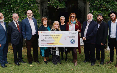 The Jewish Children's Aid Society presents a cheque for $600,000 to the principals of Melbourne's Jewish schools. Photo: Peter Haskin