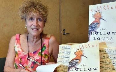 Author Leah Kaminsky with copies of her latest novel, The Hollow Bones. Photos: Noel Kessel