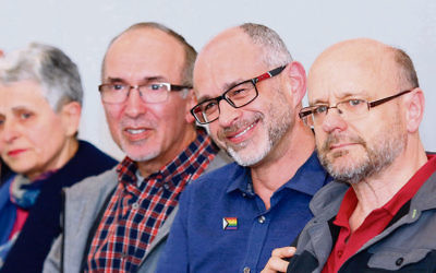 A beaming Michael Barnett (second from right) of Aleph Melbourne with husband Gregory Storer (right) after the historic apology motion was accepted at Monday night's JCCV plenum. Photo: Peter Haskin