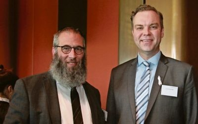 Jamie Parker (right) with Rabbi Mendel Kastel at the NSW Parliament Chanukah event in 2016. Photo: Shane Desiatnik