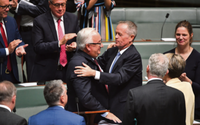 Applause for Michael Danby and an embrace from Opposition Leader Bill Shorten last week. Photo: AAP Image/Mick Tsikas