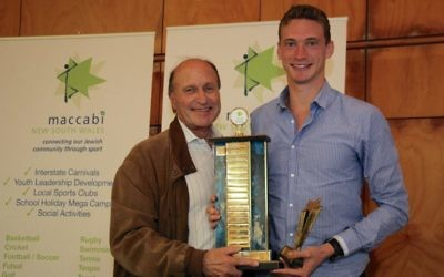 Steven Solomon (right) accepting the Maccabi NSW Sportsman of the Year award and Lou Rose Trophy from Maccabi World Union vice-president Tom Goldman on March 31. Photo: Shane Desiatnik