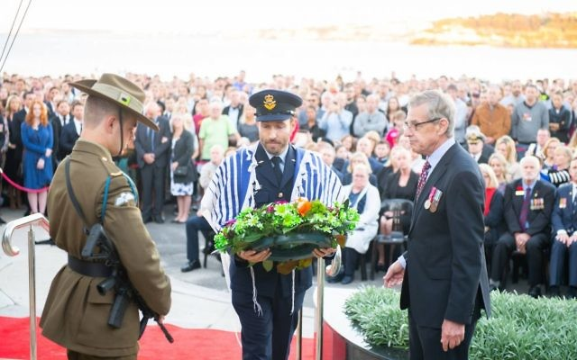 Rabbi Yossi Friedman laying a wreath at the service.