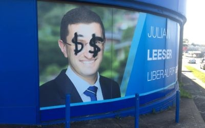 The poster for Berowra MP Julian Leeser defaced with dollar signs over his eyes.