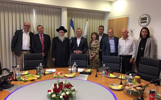 Yaakov Litzman (third left) and Roger Cook (fourth left).
