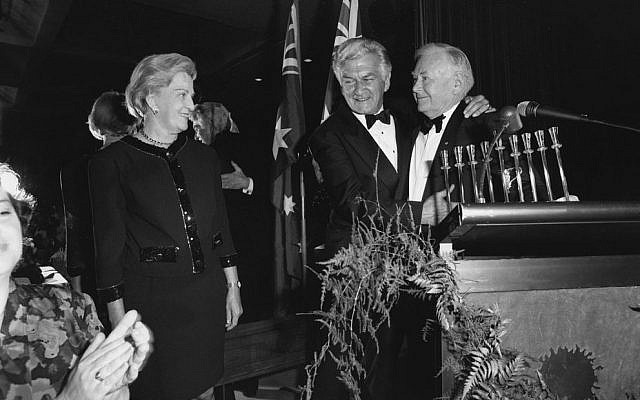 Saul Same presents Bob and Hazel Hawke with a silver menorah. Photo: AJN file