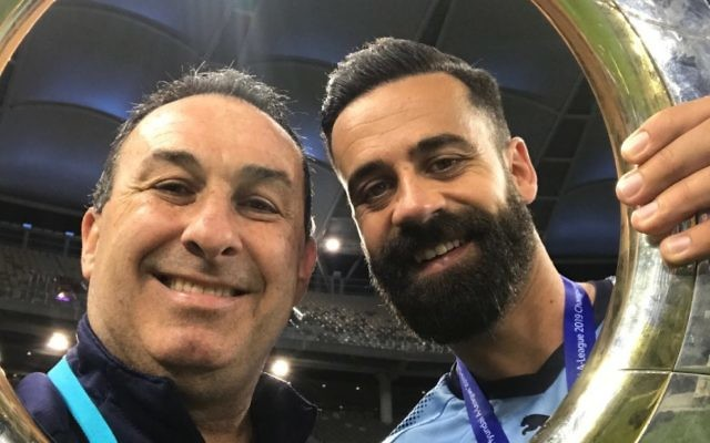 Michael Swibel (left) and retiring Sydney FC captain Alex Brosque hold the 2018/19 A-League trophy at Optus Stadium in Perth last Sunday.