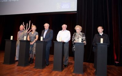 Holocaust survivors light the memorial candles. Photo: Giselle Haber