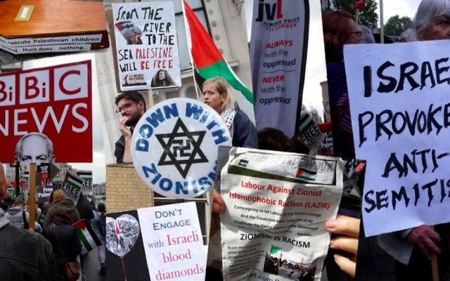 Signs carried and badges worn at the National Demonstration for Palestine in central London on May 11, 2019.
