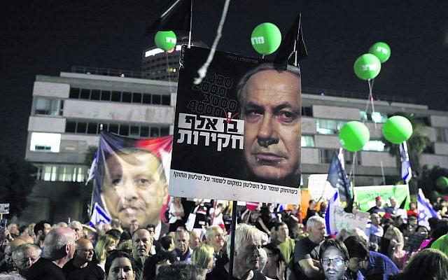 Saturday's protest in Tel Aviv against the proposed immunity legislation Photo: EPA/Abir Sultan