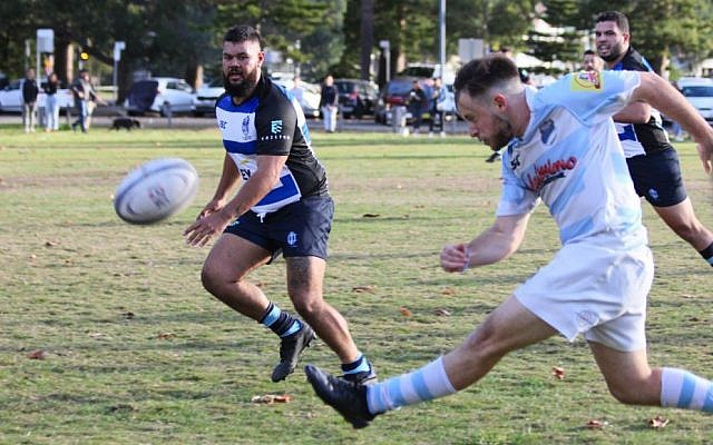 Maccabi's Dylan Jacobson gets a kick away against the Sydney Convicts at Lyne Park last Saturday. Photo: Tim Wilson