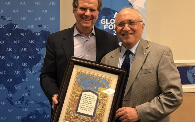 Colin Rubenstein (right) receives an award from the American Jewish Committee's David Harris.