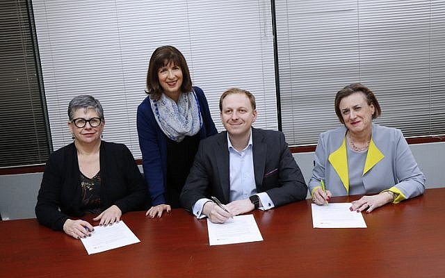 NCJWA (Vic) president Miriam Bass (second from left) oversees the signing of the NCJWA Gender Equality Pledge by (from left) Jennifer Huppert (JCCV), Jeremy Leibler (ZFA) and Sharene Hambur (Zionism Victoria). Photo: Peter Haskin