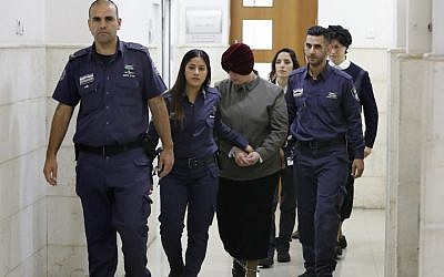 Malka Leifer is escorted by police as she arrives for a hearing at the District Court in Jerusalem, Feb. 27, 2018. (Ahmad Gharabli/AFP/Getty Images)