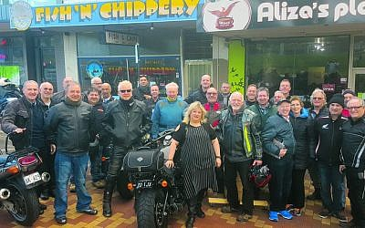 Bikers from Yids on Wheels visit Aliza's Place cafe to show solidarity with proprietor Aliza Shuvaly (front).