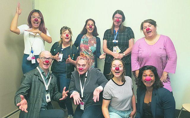 David Symons (bottom left), Shoshi Ofir (top, third from left) and the RCH's Victorian Paediatric Medical Service director Dr Anne Smith (top, second from right) together with the RCH trainee clown doctors of the Humour Foundation and Dream Doctors pilot program.