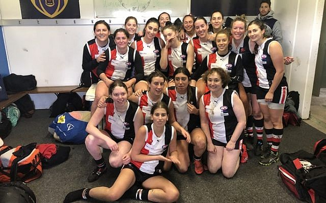 Sam Hall (in the first row on the far right) celebrates last Saturday's win with her AJAX teammates.