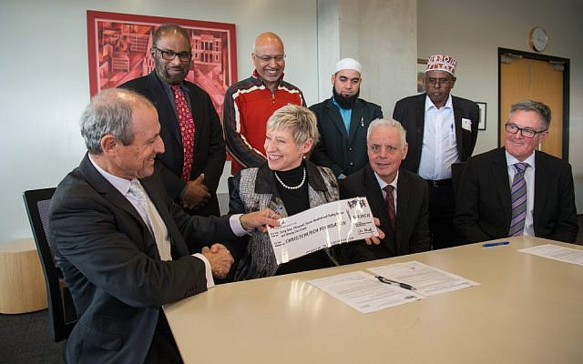 Vic Alhadeff (left) presents a cheque to Christchurch mayor Lianne Dalziel flanked by Jewish and Muslim community leaders. Photo: Neil Macbeth