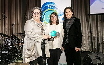 Claire Gil-Munoz (centre) and Isabelle Shapiro (right) accepting the award from Cathy Tobin at the National Suicide Prevention Conference on July 23. Photo: Raimond Aide