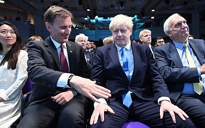 Foreign Secretary Jeremy Hunt, left, extending a hand to congratulate Boris Johnson for being elected as the new leader of the Conservative Party and British Prime Minister in London, July 23, 2019. (Stefan Rousseau - WPA Pool/Getty Images)