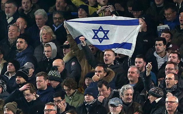 Soccer supporters hold an Israeli flag during a past match. Photo: Charlotte Wilson/Offside/Getty Images