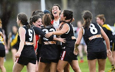The Jackettes celebrate after defeating Richmond Central in the VAFA women's Division 4 preliminary final.