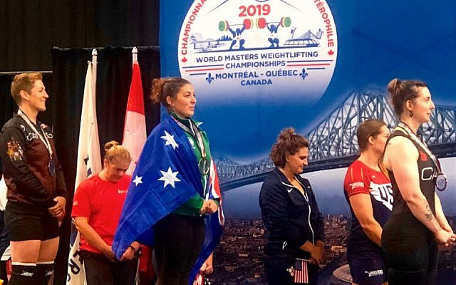 Australia's Leora Yates at the medal ceremony at the 2019 World Masters Weightlifting Championships.