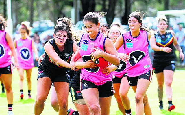Izzy Worth on the charge for the Jackettes in the VAFA women's Division 4 grand final against Glen Eira last Sunday. Photo: Peter Haskin