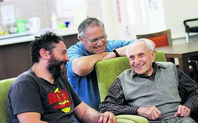 Leo Buchler (right) after his 108th birthday last year, with grandson David (left) and son Paul. Photo: Peter Haskin