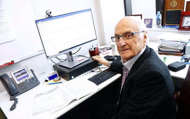 Professor Paul Zimmet at his desk at the Alfred Centre in Melbourne. Photo: Peter Haskin