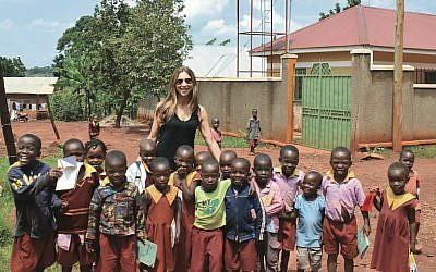 Author Suzy Zail with schoolchildren in Uganda during her 2015 research trip.