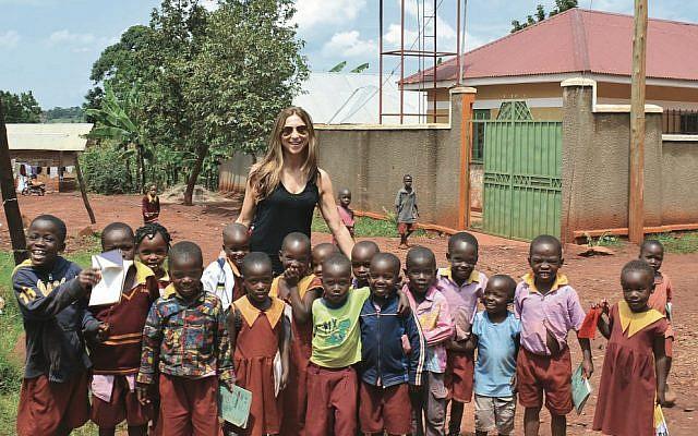 Author Suzy Zail with schoolchildren in Uganda during her 2015 research trip.