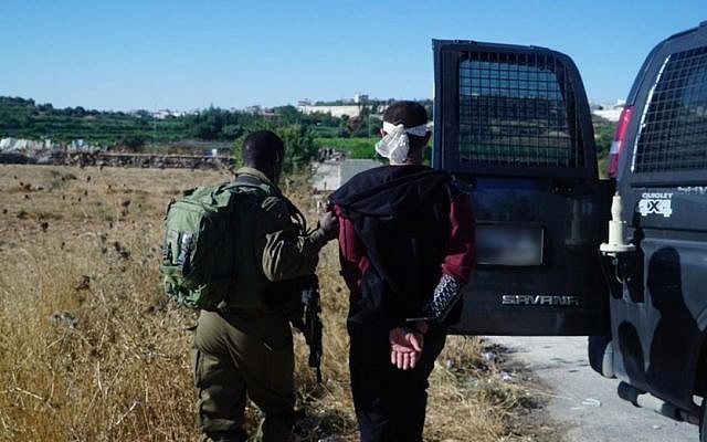 Israeli soldiers arrest two Palestinian men suspected in the muirder of yeshiva student Dvir Sorek on Aug. 10, 2019 from their homes in the Palestinian village Beit Khalil, north of Hebron in the West Bank. Photo: IDF
