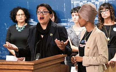 Rashida Tlaib (left) speaks at a news conference on Friday as Ilhan Omar (right) looks on. Photo: EPA/Craig Lassig