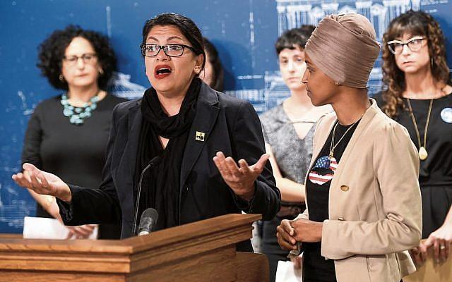 Rashida Tlaib (left) speaks at a news conference on Friday as Ilhan Omar (right) looks on. Photo: EPA/Craig Lassig